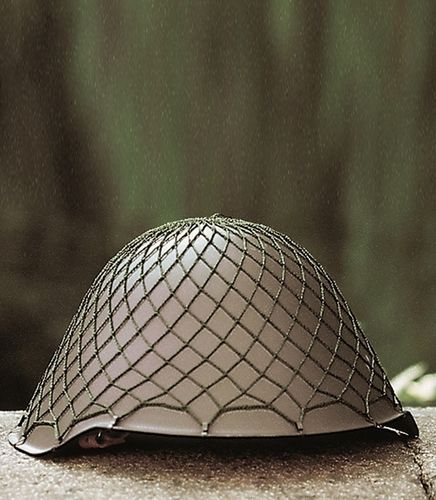 NVA helmet with net cover, used