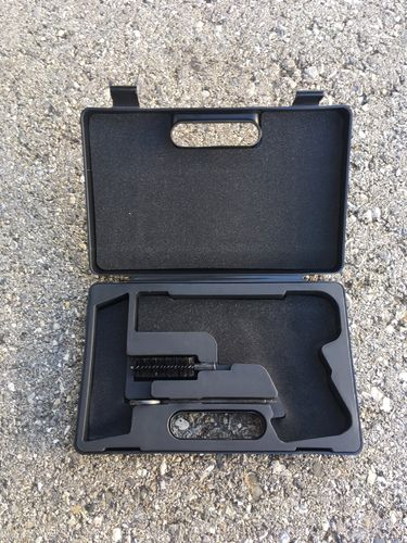 Colt 1911 pistol case with cleaning rod and brush